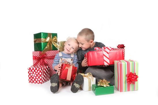Happy Children Enjoying Christmas Gifts
