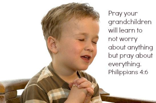 Five year old boy praying and singing